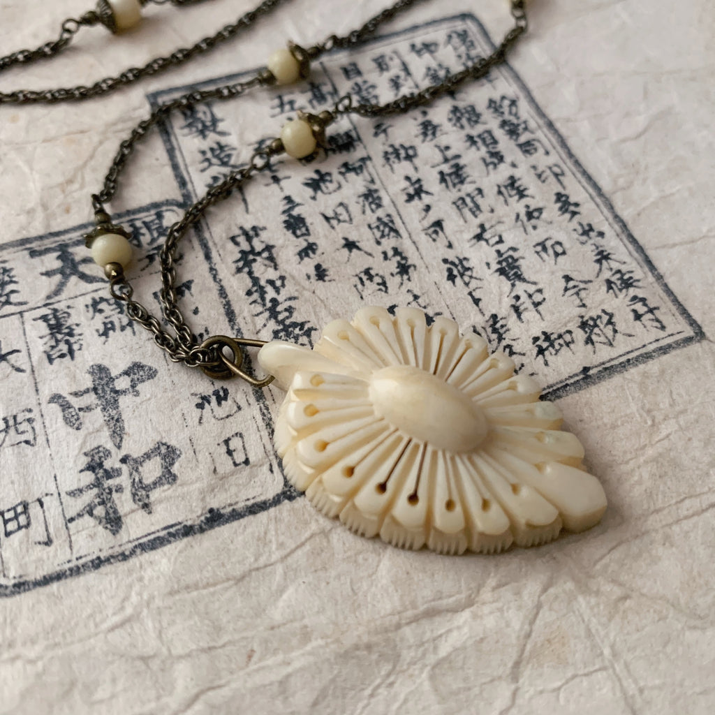 tabito : brass necklace with carved bone pendant