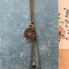 tabito : brass necklace with vintage pin pendant