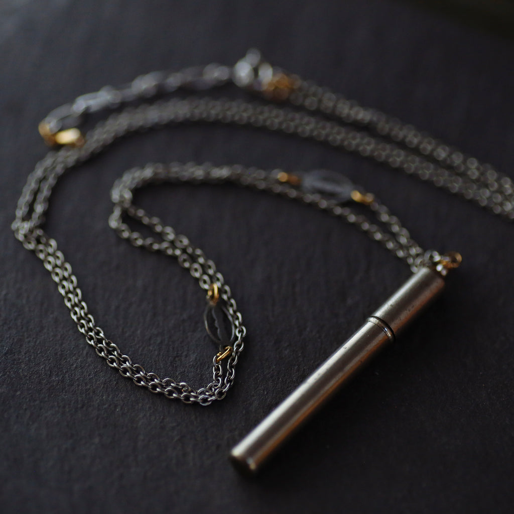 tabito :  chromed needle case necklace