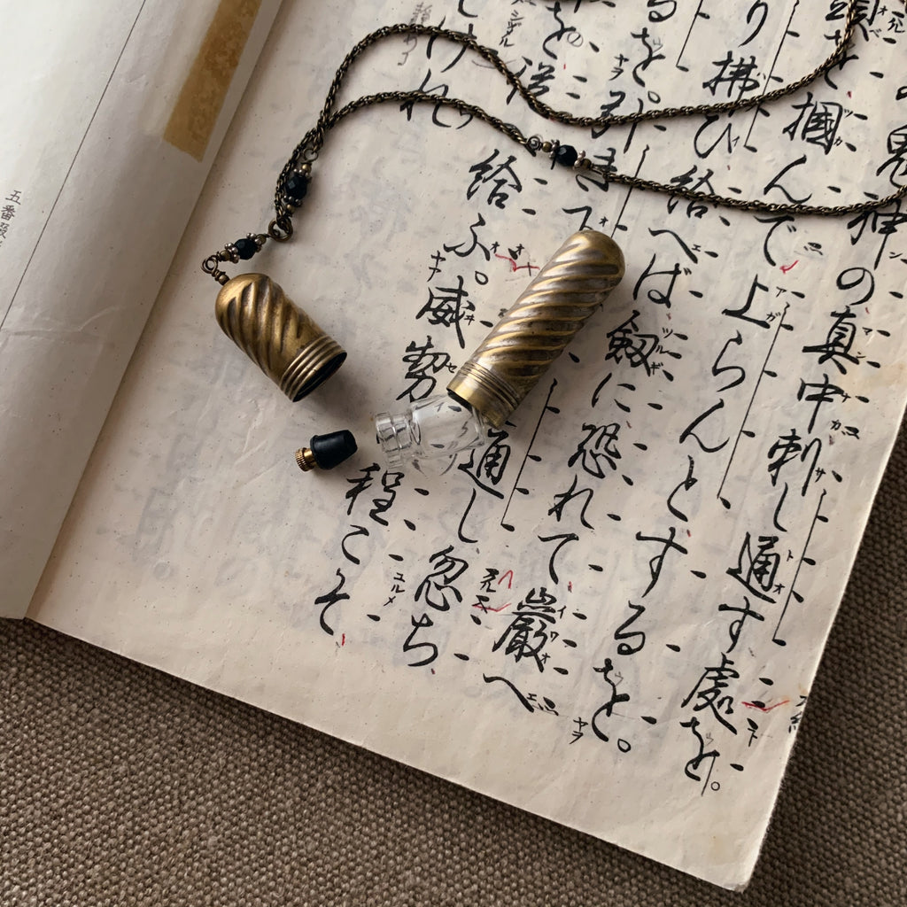 tabito : brass necklace with needle container pendant