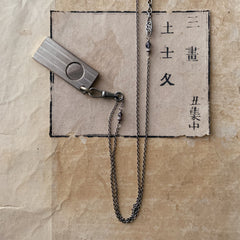 tabito : chrome brass necklace with vintage steel cigar cutter pendant