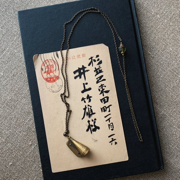 tabito : brass necklace with vintage pencil sharpener pendant