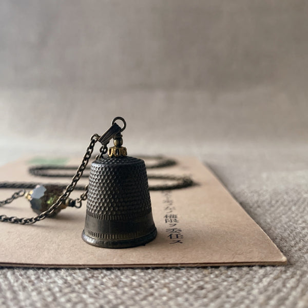 tabito : brass necklace with small brass thimble pendant