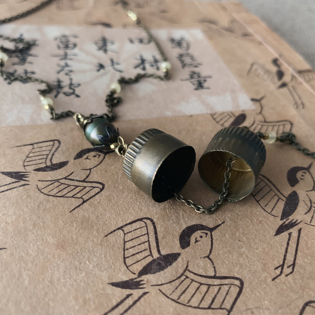 tabito : brass necklace with pigeon ring case pendant