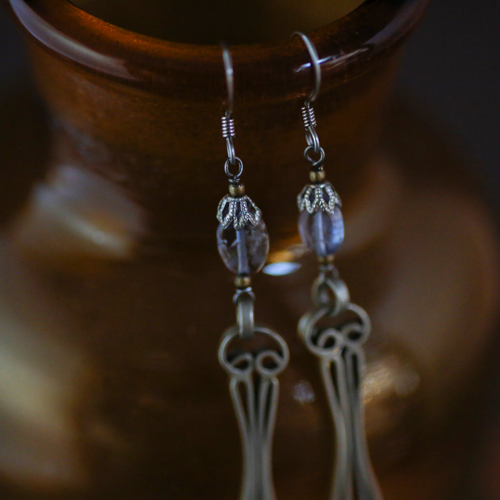 tabito : earrings tanzanite with antique pocket watch parts