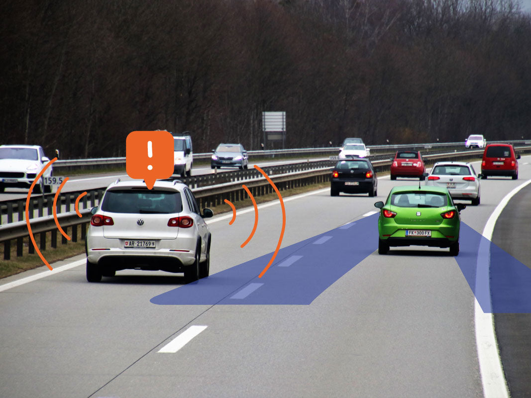 Diagram of a car driving down an interstate giving off false alerts via their blind spot monitoring system.