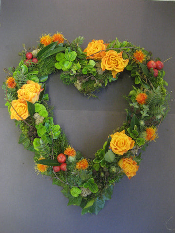 Heart-shaped wreath in green and orange