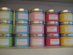 Stacked candles in tins