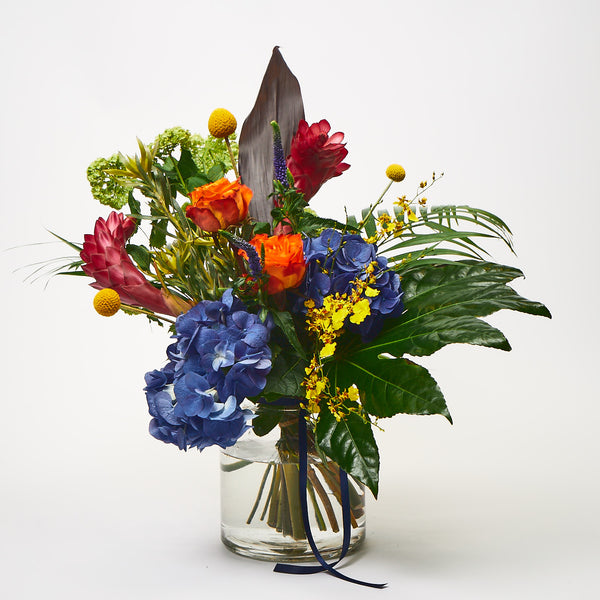 Kinky Afro (Blue hydrangea / Orange roses / Craspedia / Pink gingers / Purple veronica / Viburnum / Palm leaves / Aralia leaves)