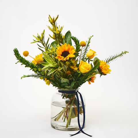 A Clockwork Orange (Sunflowers / Yellow roses / Craspedia / Ornithogalum / Leucadendron / Ferns)