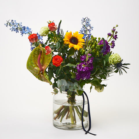 Crazy Sue (Delphinium / Anthurium / Stocks / Sunflowers / Roses / Veronica / Thistle / Viburnum)