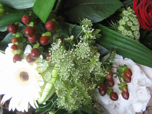 Close up hypericum berries, white gerbera, white hydrangea and trachelium