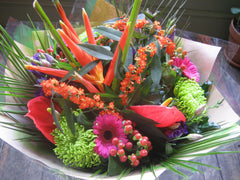 Bouquet of birds of paradise, green chrysanthemum, hypericum berries, hot pink gerbera, red anthurium and others
