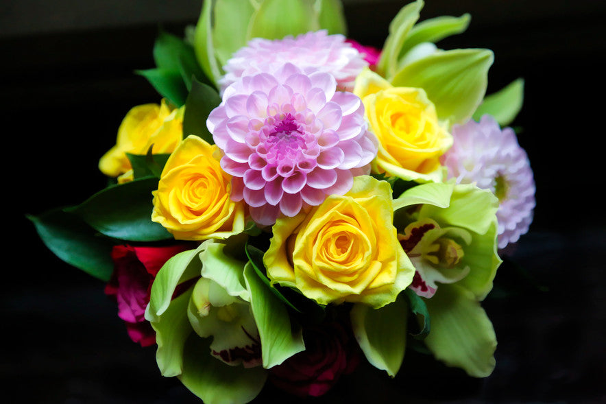 Bouquet of roses, orchid and dahlia
