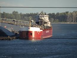 Freighter using its boom to self-unload in the great lakes