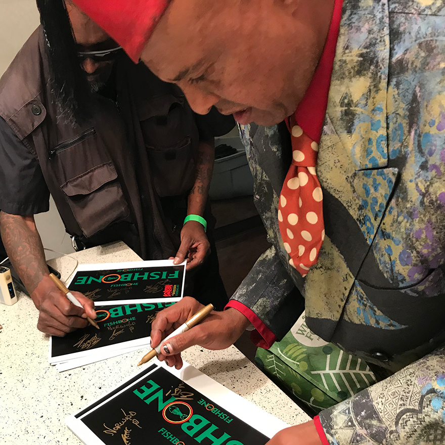 Angelo Moore and Dirty Walt signing some of the Fishbone Watch packaging