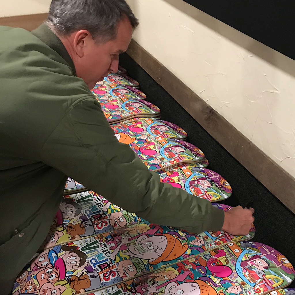 "Dave Quackenbush signing some of The Vandals ""Anarchy Burger"" Skateboard decks."