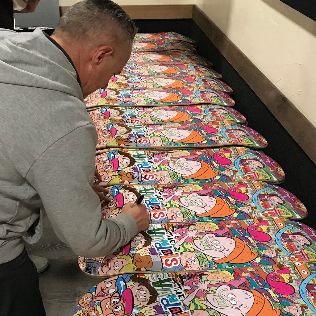 "Joe Escalante signing some of The Vandals ""Anarchy Burger"" Skateboard decks."