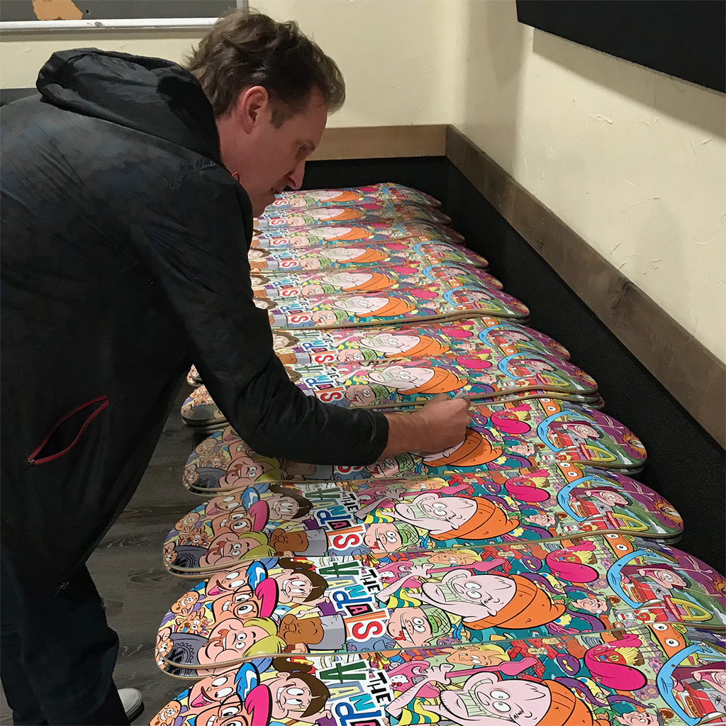 "Josh Freese signing some of The Vandals ""Anarchy Burger"" Skateboard decks."