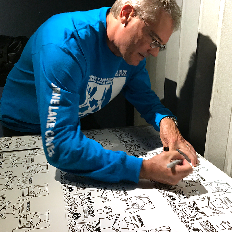 Milo Auckerman signing DESCENDENTS Everything Sucks Vannen packaging