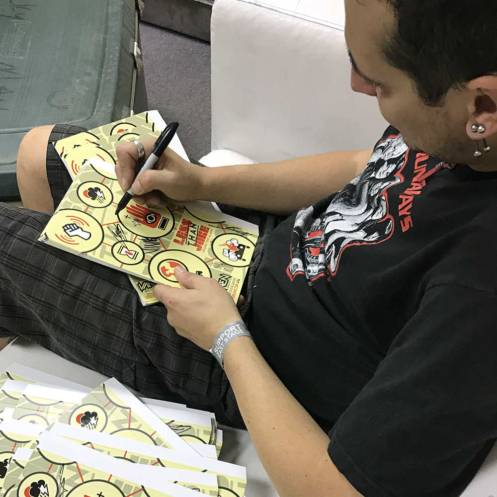 Roger Lima of Less Than Jake signing Vannen Watch packaging