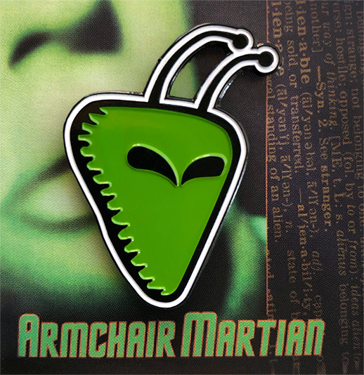 Armchair Martian enamel pin on card back.