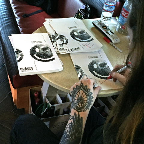 Laura Jane Grace signing Mandatory Happiness Vannen Watch packaging