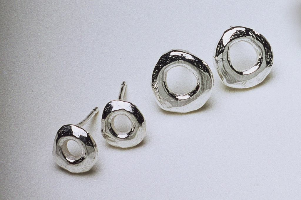 Tiny Silver Circle Stud Earrings by Fiona DeMarco