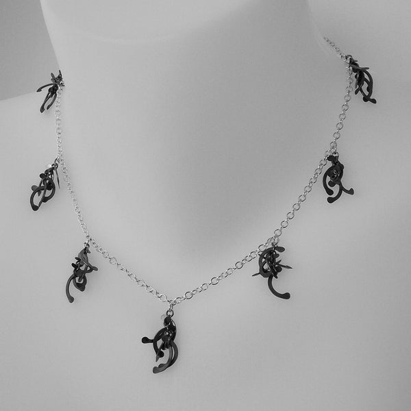 Contour charm Necklace, oxidised silver by Fiona DeMarco