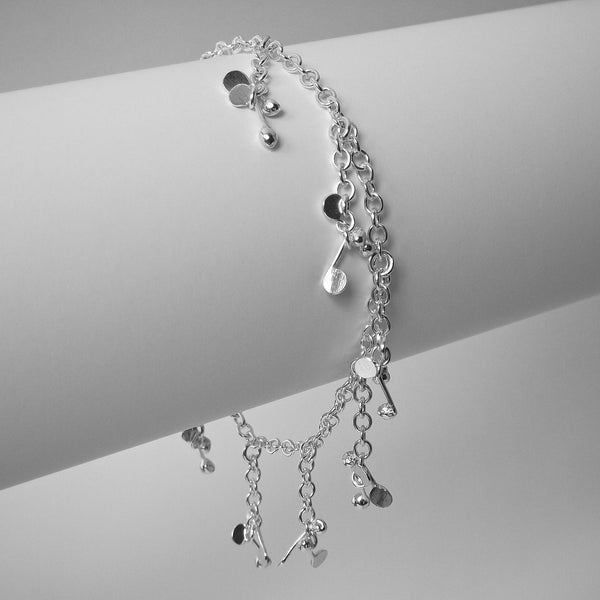 Accent charm Bracelet, polished silver by Fiona DeMarco