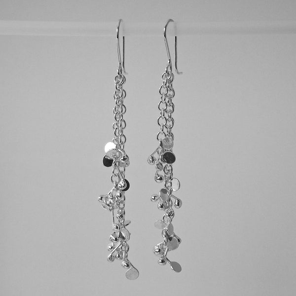 Accent dangling Earrings, polished silver by Fiona DeMarco