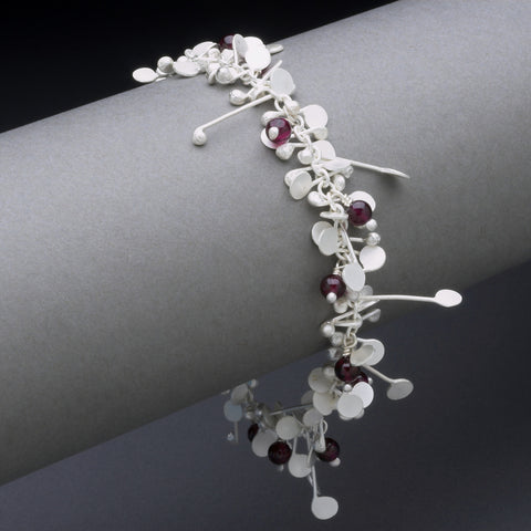 Blossom & Bloom Bracelet with garnet, satin silver by Fiona DeMarco