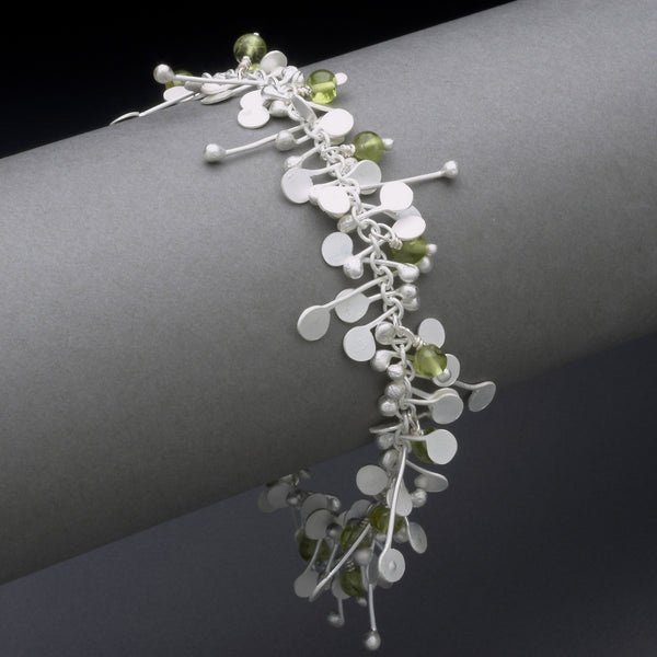 Blossom & Bloom Bracelet with peridot, satin silver by Fiona DeMarco