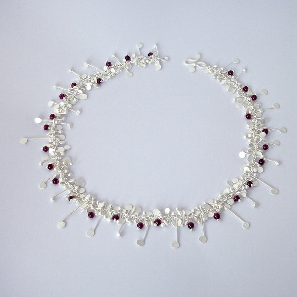 Blossom & Bloom Necklace with garnet, satin silver by Fiona DeMarco