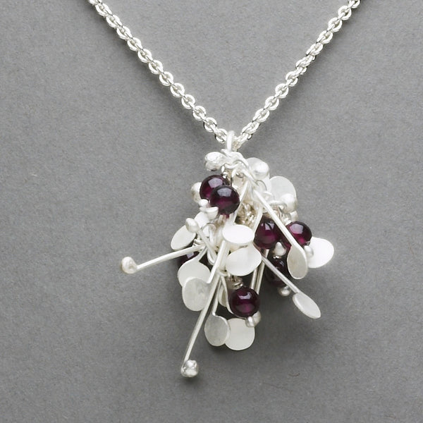 Blossom & Bloom Pendant with garnet, satin silver by Fiona DeMarco