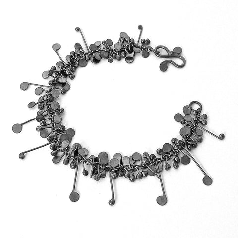 Blossom Bracelet, oxidised silver by Fiona DeMarco