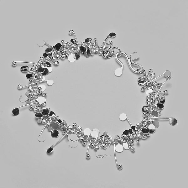 Blossom Bracelet, polished silver by Fiona DeMarco
