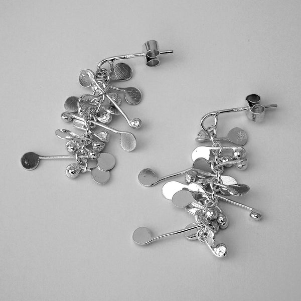 Blossom stud Earrings, polished silver by Fiona DeMarco