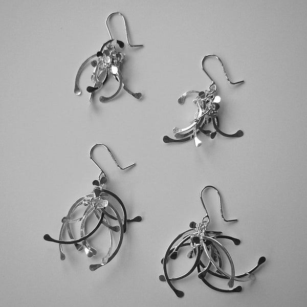 Contour Cluster dangling Earrings and Contour Cluster multi dangling Earrings, polished silver by Fiona DeMarco