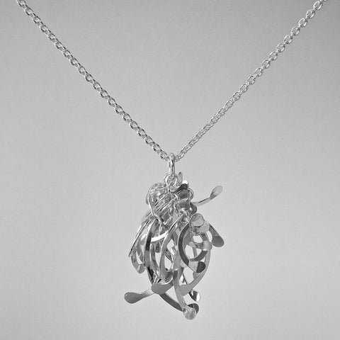 Contour Cluster Pendant, polished silver by Fiona DeMarco