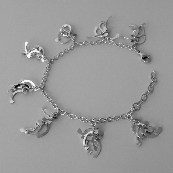 Contour charm Bracelet, polished silver by Fiona DeMarco