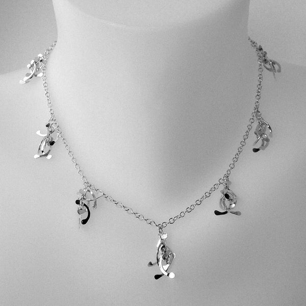 Contour charm Necklace, polished silver by Fiona DeMarco