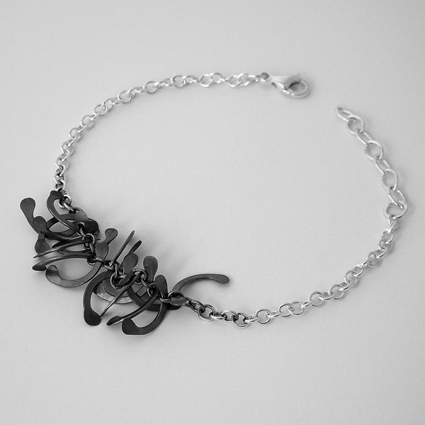Contour semi Bracelet, oxidised silver by Fiona DeMarco