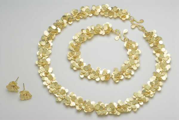 Symphony Precious collection, 18ct yellow gold satin by Fiona DeMarco