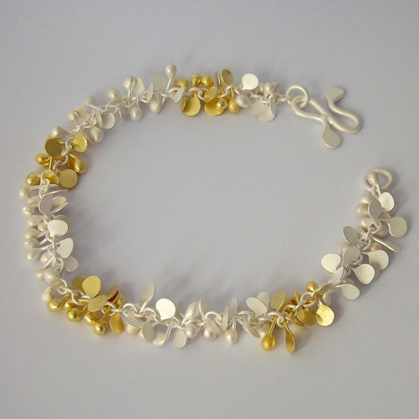 Harmony duo bracelet, 18ct yellow gold and silver, satin by Fiona DeMarco