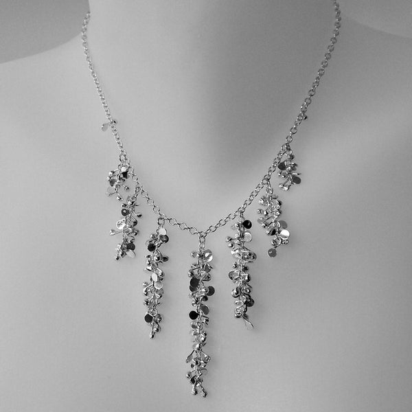 Harmony semi graduated Necklace, polished silver by Fiona DeMarco