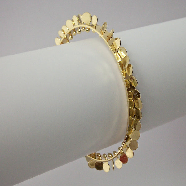 Icon Precious Bangle, 18ct yellow gold polished by Fiona DeMarco