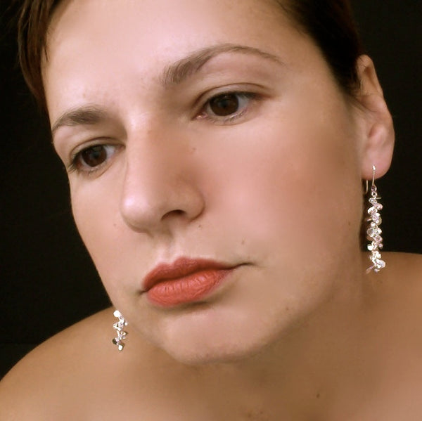 Harmony dangling Earrings, polished silver by Fiona DeMarco