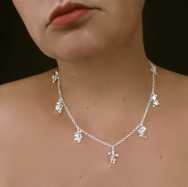 Harmony charm Necklace, polished silver by Fiona DeMarco