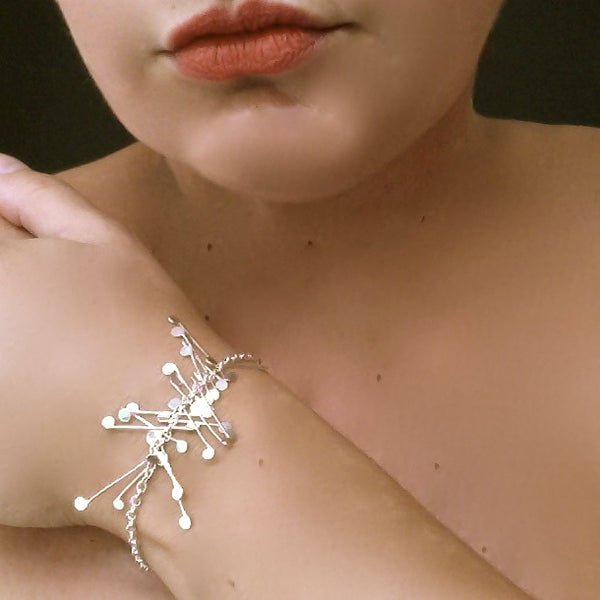 Signature semi Bracelet, polished silver by Fiona DeMarco
